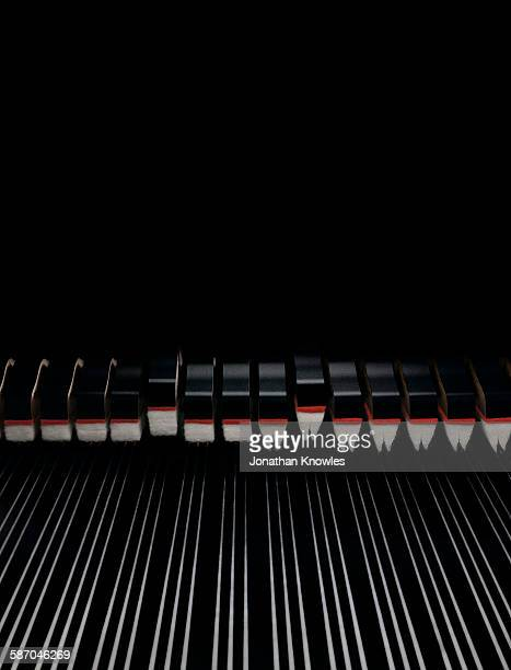 Close up of piano with strings