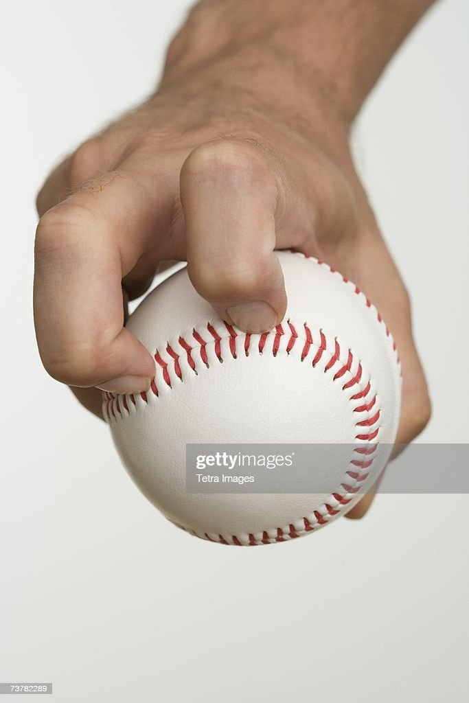 Close up of pitcher holding baseball : Stock Photo