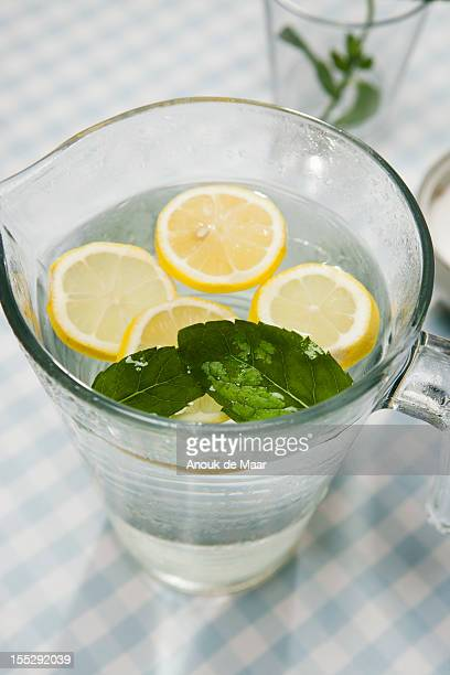Close up of pitcher of lemon water