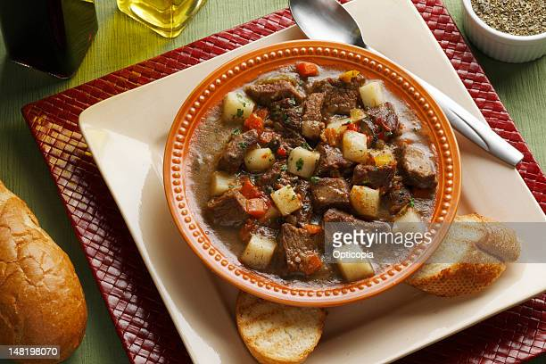 Close up of plate of stew and bread