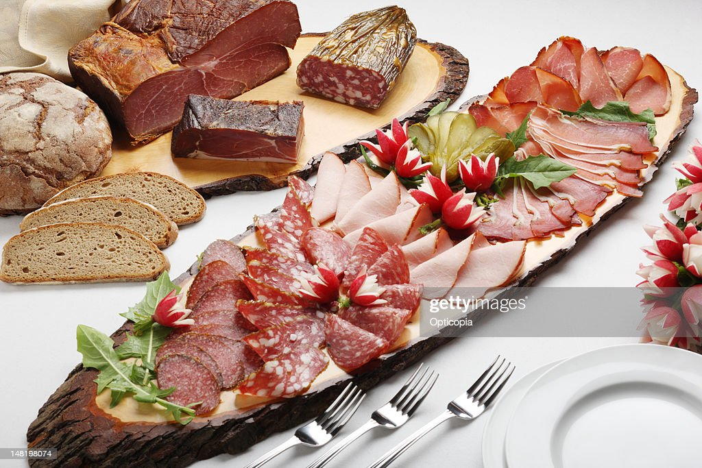 Close up of platter of meat and bread : Stock Photo