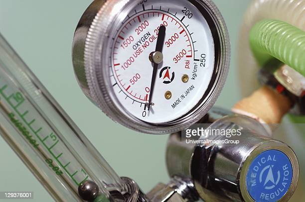 Close up of pressure meter for oxygen tank attached to regulator
