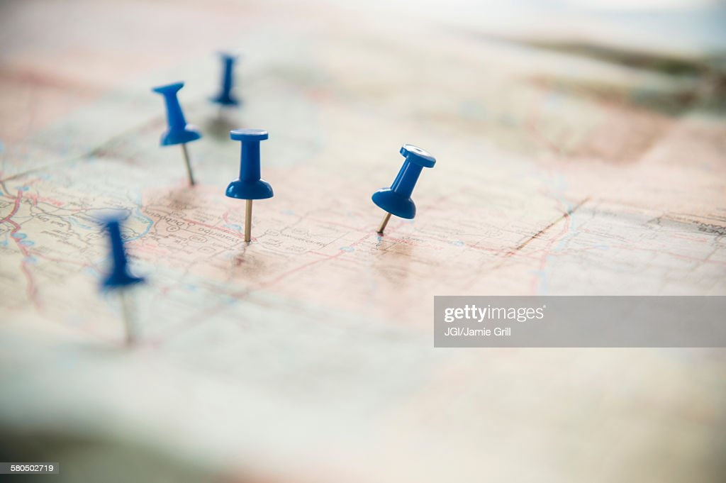 Close up of pushpins on roadmap route : Stock Photo