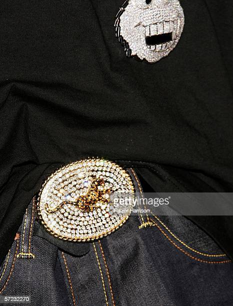 A close up of rapper Romeo's belt buckle is seen as he poses in the press room during the 19th Annual Kid's Choice Awards held at UCLA's Pauley...