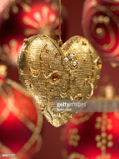 Close up of red and gold Christmas ornaments