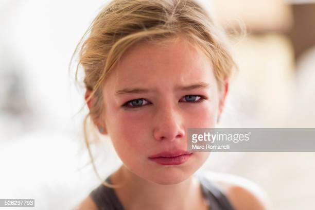 Close up of red face of crying Caucasian girl