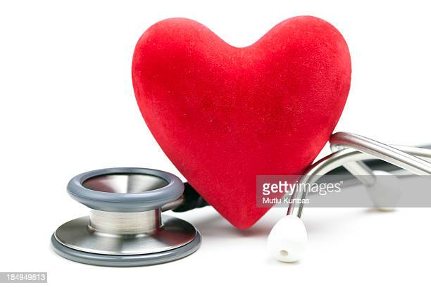 Close up of red heart and silver stethoscope