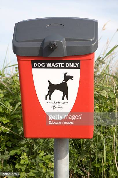 Close up of red litter bin for dog waste only Suffolk England