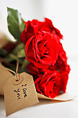 Close up of red roses with gift tag