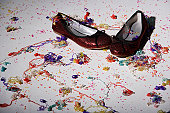 close up of red shoes with confetti on floor