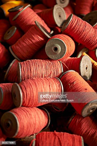 Close up of red thread bobbins, Thamel, Kathmandu, Nepal