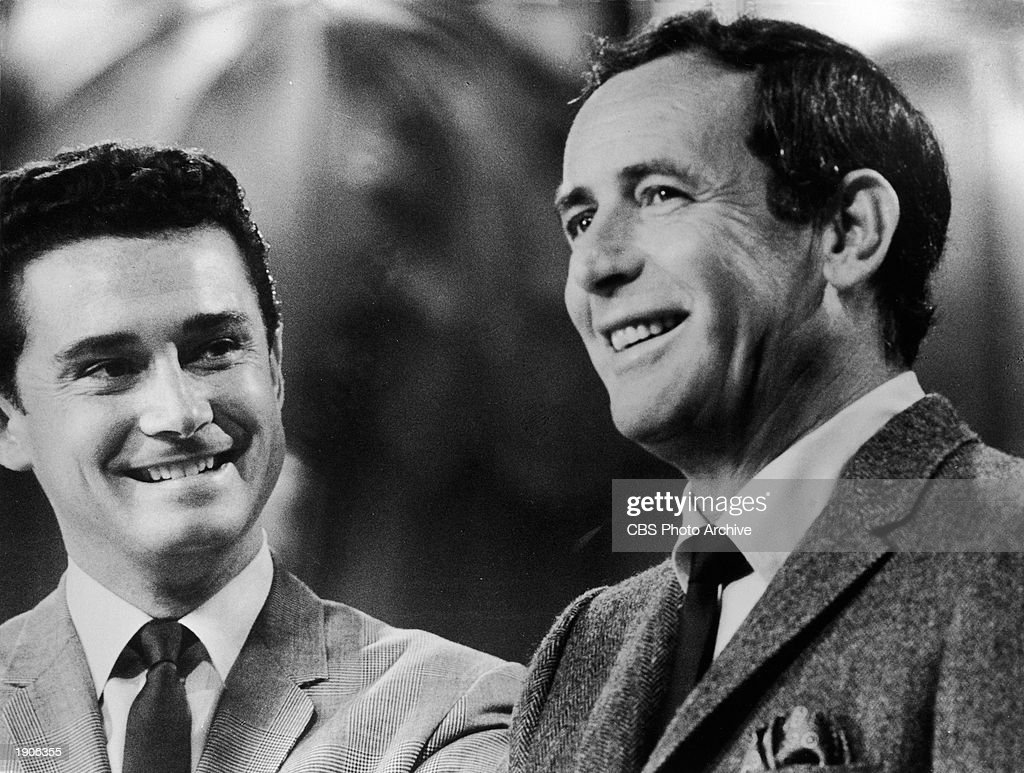 Close up of Regis Philbin (left) and Joey Bishop laughing during an episode of the television program, 'The Joey Bishop Show,' c. 1967.