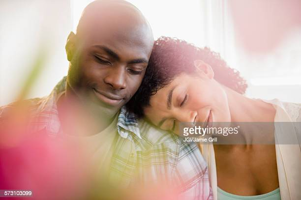 Close up of relaxing couple hugging