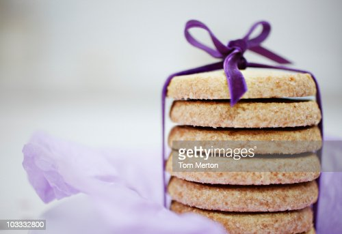 Close up of ribbon around stack of cookies : Stock Photo