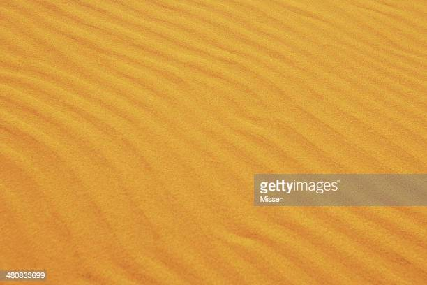 Gros plan des ondulations de sable