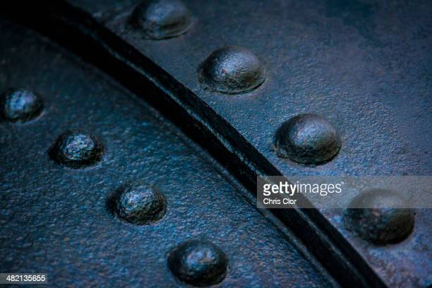 Close up of rivets on sheet metal