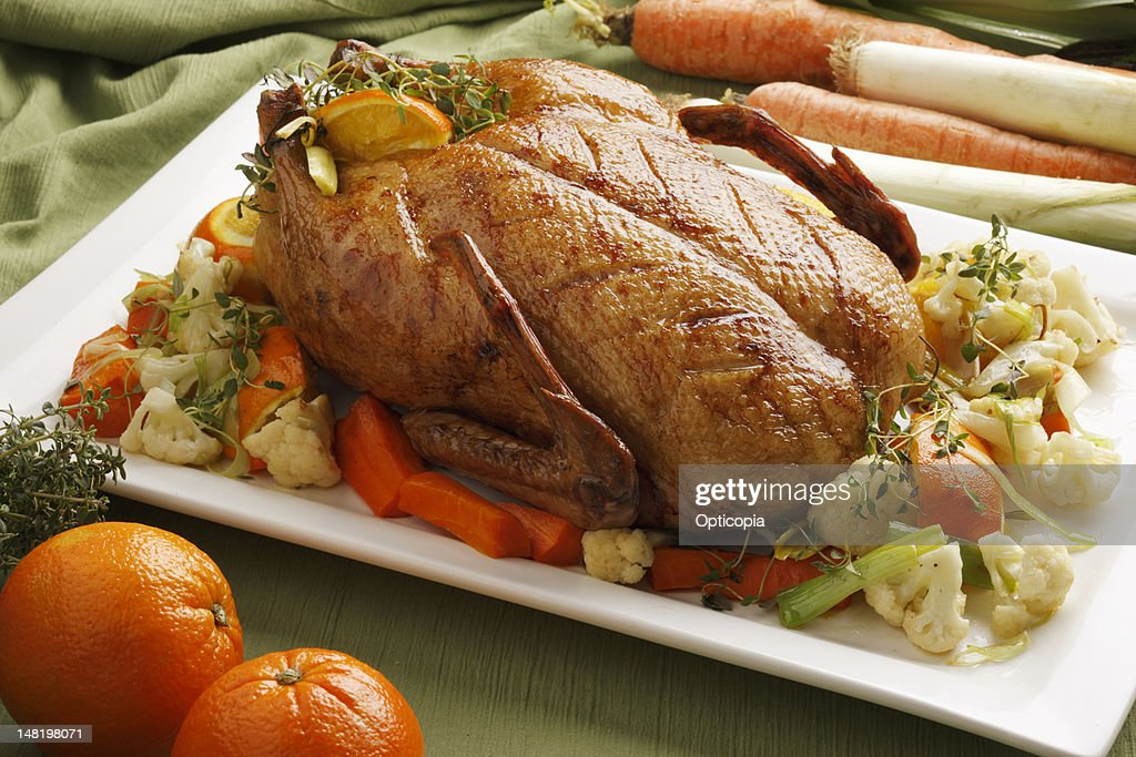 Close up of roast chicken and vegetables