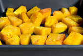 Close up of roasted butternut squash in tray