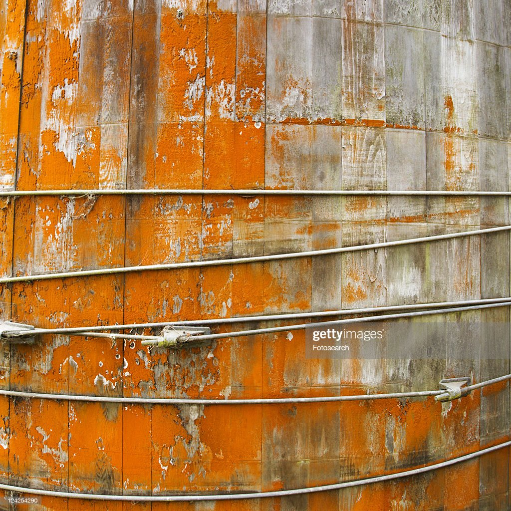 Close up of round structure with wood panels and peeling orange paint. : Stock Photo