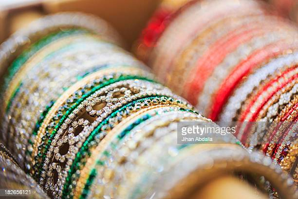 Close up of rows of bangles for sale