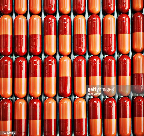 Close up of rows of pill capsules