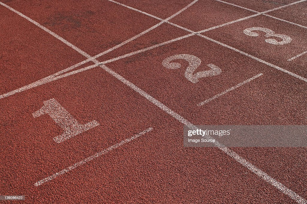 Close up of running track start lines : Stock Photo