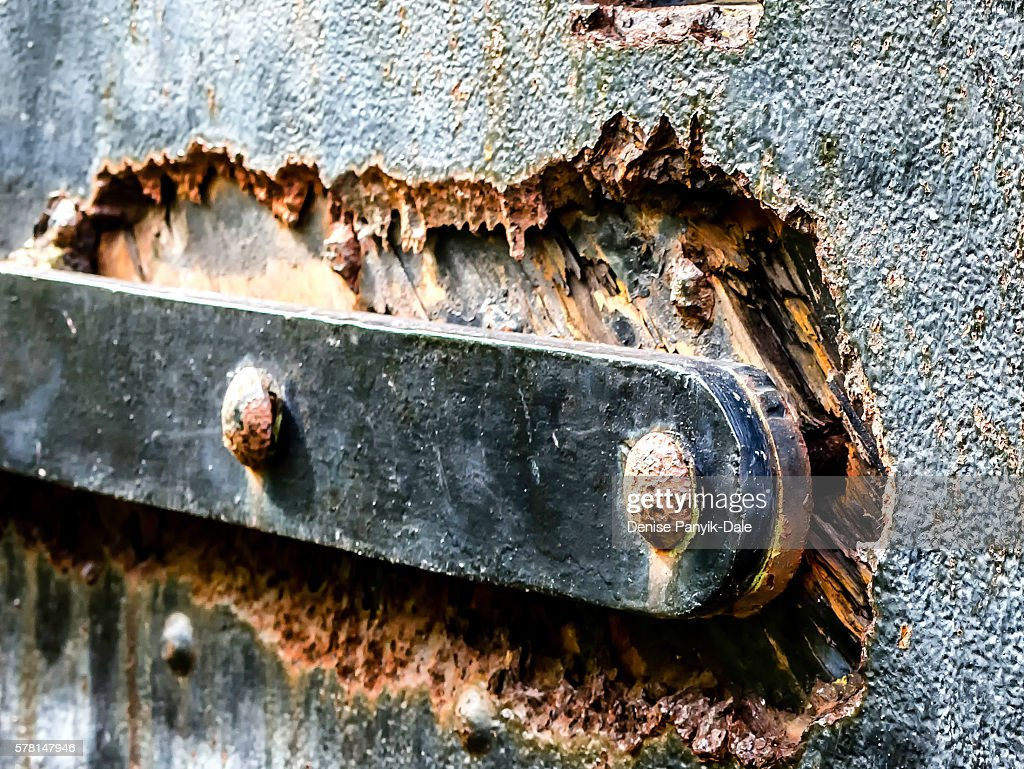 Close up of rusted bolts and latch