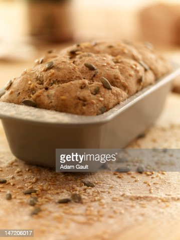 Close up of rustic bread in loaf pan : Stock Photo