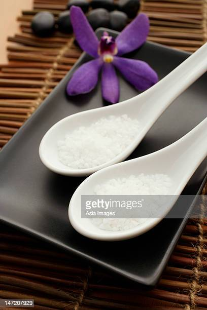 Close up of salt in spoons for spa.