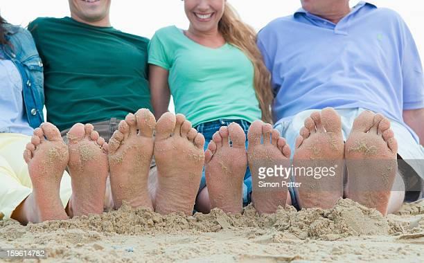 Close up of sandy feet on beach