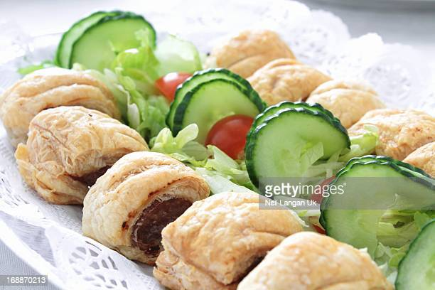 close up of sausage roll slices on buffet table