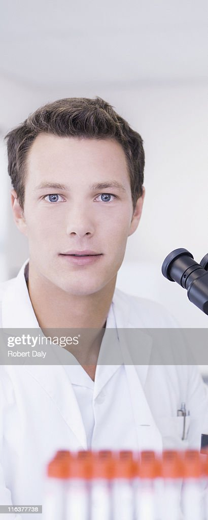 Close up of scientist with microscope : Stock Photo