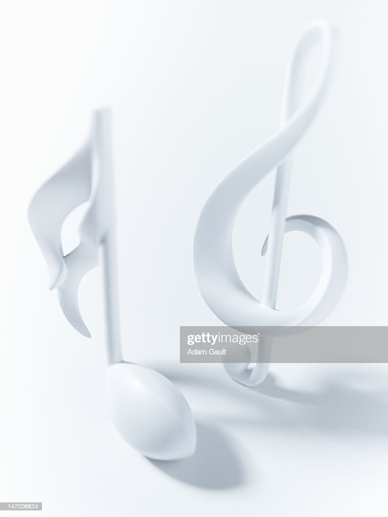 Close up of semiquaver and treble clef musical notes on white background : Stock Photo