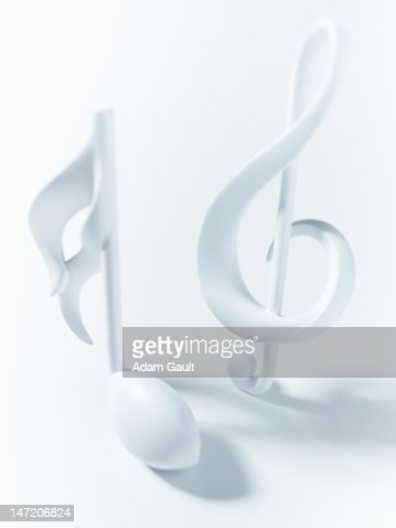 Close up of semiquaver and treble clef musical notes on white background
