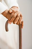 Close up of senior African woman leaning on cane