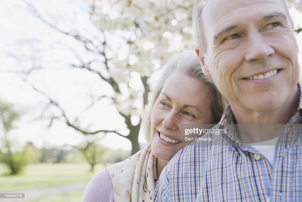 Close up of senior couple hugging : Stock Photo