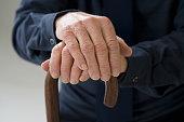 Close up of senior Hispanic man¿s hands on cane