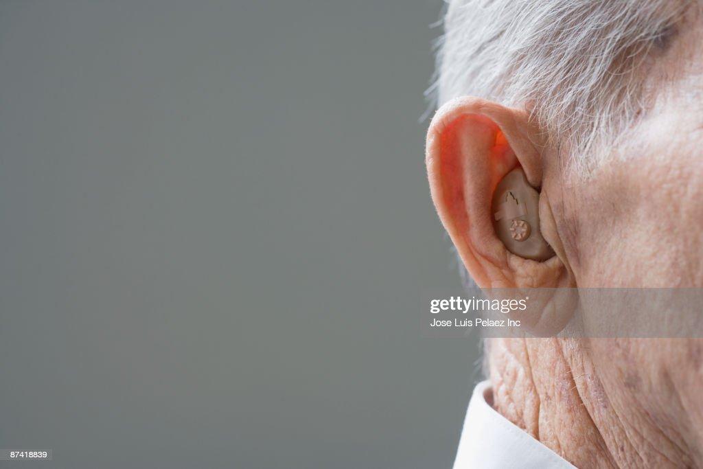Close up of senior Hispanic man¿s hearing aid