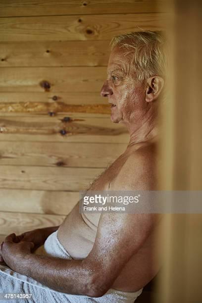 Close up of senior man sitting in sauna