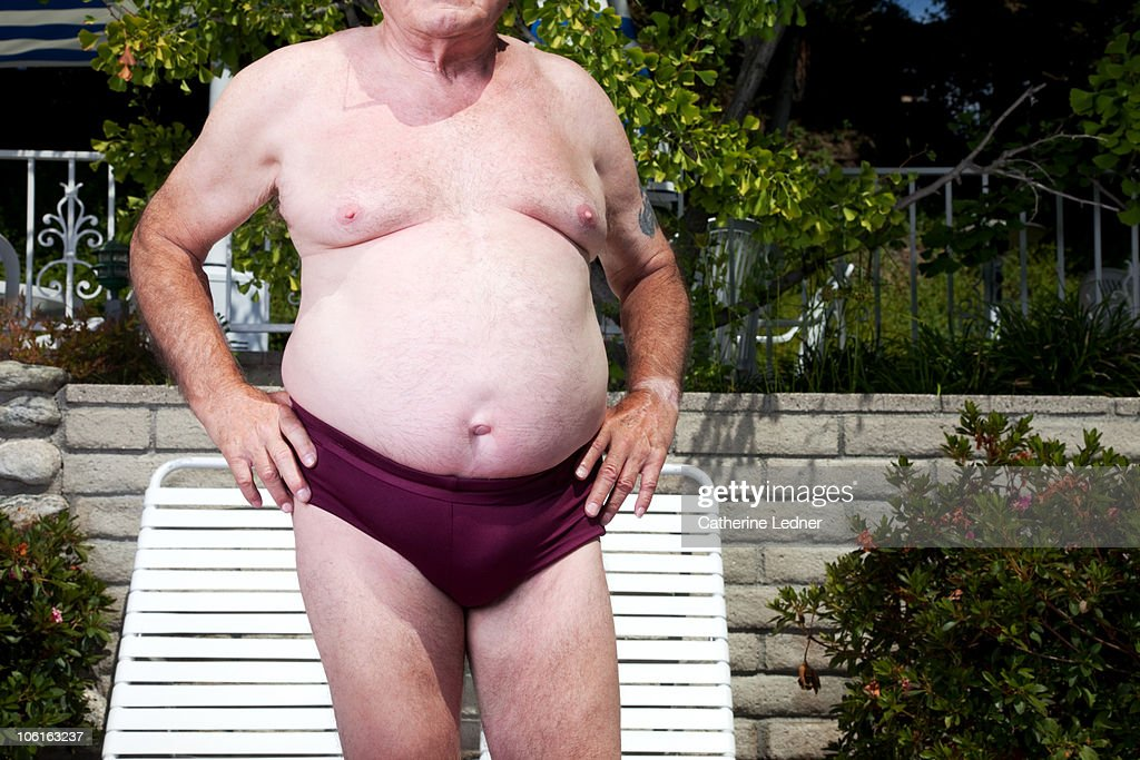 Close up of senior man's stomach : Stock Photo
