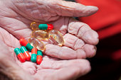 Close up of senior woman's hands holding pills
