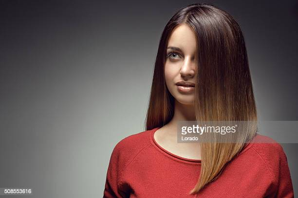 close up of sensual brunette with long straight hair