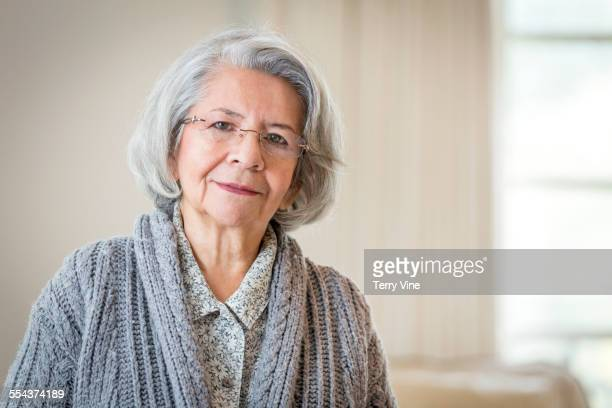 Close up of serious face of older Hispanic woman