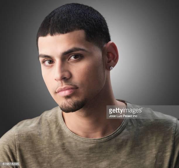 Close up of serious Hispanic man