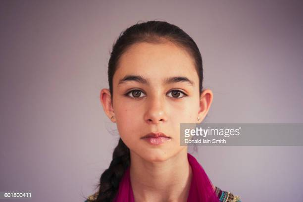 Close up of serious mixed race girl