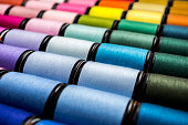 Colorful Background close up of sewing spool of threads