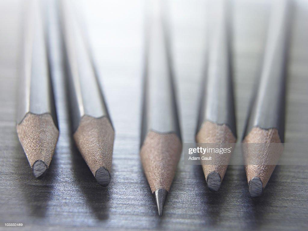 Close up of sharp pencil among dull pencils