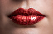 Close up of shiny metallic looking red lips