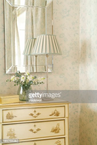 Close up of sideboard against wallpaper : Stock Photo