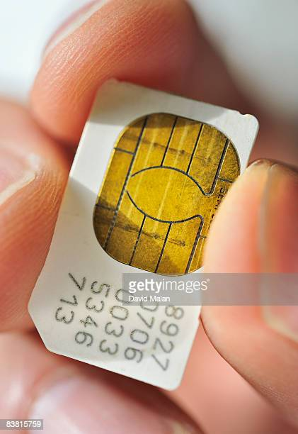 close up of sim card in mans hands